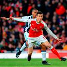 West Bromwich Albion's Jose Salomon Rondon (behind) and Arsenal's Laurent Koscielny battle for the ball yesterday