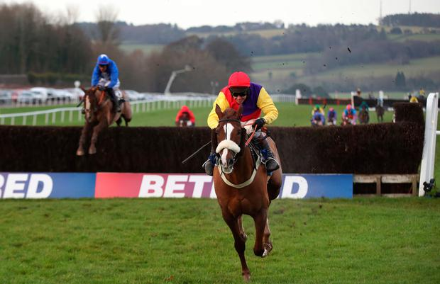 Native River ridden by jockey Richard Johnson clears the last and wins The Coral Welsh Grand National Handicap at Chepstow Racecourse