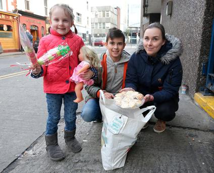 Lina Tumene, with her children, Mia McGauley (5), and Modetas Tumenas (11), pictured before they gave a donation into Apollo House yesterday. Photo: Damien Eagers
