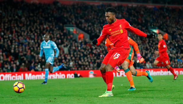 Liverpool's Daniel Sturridge scores their fourth goal against Stoke City at Anfield. Photo: Reuters
