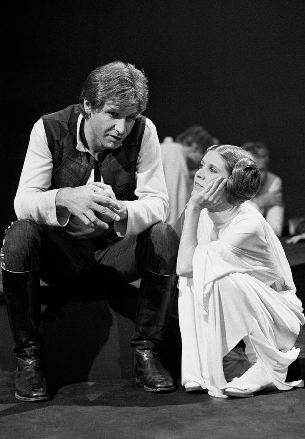 Carrie Fisher as Princess Leia with Harrison Ford. (AP Photo/George Brich, File)