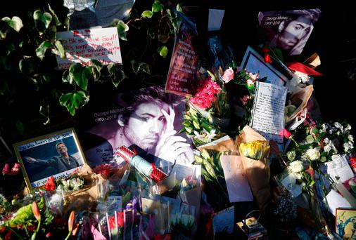 Tributes to George Michael outside his London home. Photo: REUTERS/Neil Hall