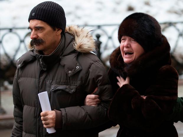 Relatives cry in front of the Red Army Choir building in Moscow. (AP Photo/Ivan Sekretarev)