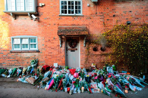 Candles and messages from fans pile up outside George's home in the English village of Goring. (Photo by Jack Taylor/Getty Images)