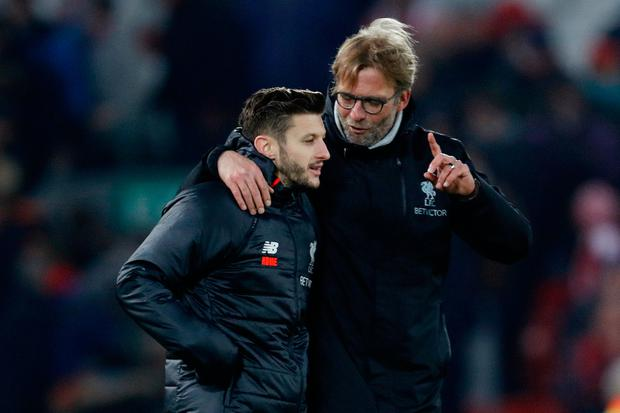 Liverpool manager Juergen Klopp celebrates with Adam Lallana