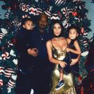 Kim and Kanye pose on Christmas Day with their two children North (3) and Saint (1)