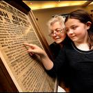 Carmel Dawson and her granddaughter Alannagh McKutcheon take a look at the 1916 Proclamation. Photo: Steve Humphreys