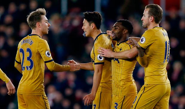 Tottenham's Son Heung-min celebrates scoring their third goal with teammates