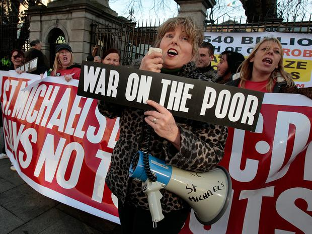 Rita Fagan and members of the Family Resource Centre from St Michael's Estate in Inchicore protest at Leinster House over Budget cuts. Photo: Tom Burke
