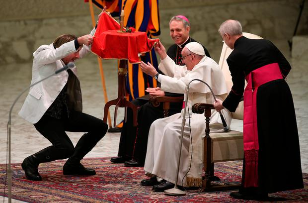 Pope Francis checks underneath a levitating table during the Golden Circus' performance at The Vatican yesterday Picture: REUTERS/Alessandro Bianchi