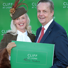 Gillian Gilbourne from Mill Street in Cork is congratulated by Adriaan Bartels -General Manager at Cliff House Hotel Collection after winning