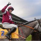29 December 2016; Jockey Bryan Cooper celebrates after winning the Ryanair Hurdle on Petit Mouchoir during day four of the Leopardstown Christmas Festival in Leopardstown, Dublin. Photo by Eóin Noonan/Sportsfile