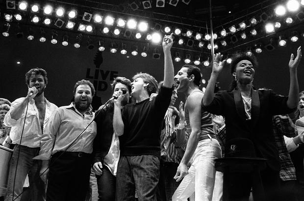 George Michael, promoter Harvey Goldsmith, Bono, Paul McCartney, Bob Geldof and Freddie Mercury join in the finale of Live Aid. Photo: AP