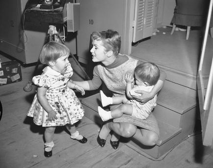 Debbie Reynolds is visited at the studio by her children, Carrie (2) and Todd (1), on the set of 'Say One For Me' in February 1959
