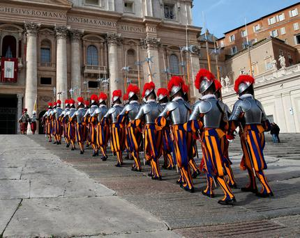 """Swiss Guards arrive before Pope Francis delivered his """"Urbi et Orbi"""" (to the city and the world) message from the balcony overlooking St. Peter's Square at the Vatican on Christmas Day. Photo: Alessandro Bianchi/Reuters"""