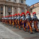 "Swiss Guards arrive before Pope Francis delivered his ""Urbi et Orbi"" (to the city and the world) message from the balcony overlooking St. Peter's Square at the Vatican on Christmas Day. Photo: Alessandro Bianchi/Reuters"