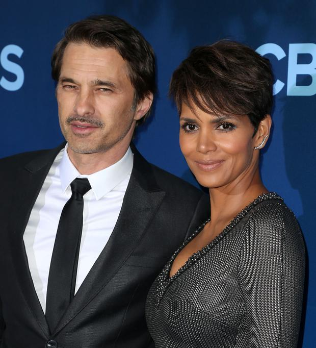 Actress Halle Berry (R) and Oliver Martinez attend the Premiere of CBS Television Studios & Amblin Television's