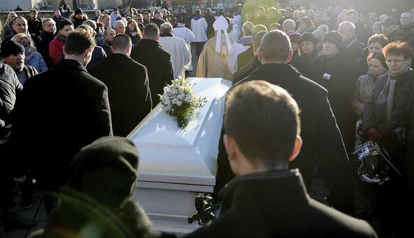 People gather in front of the church after a funeral mass for the Polish truck driver Lukasz Urban, who was killed in the Berlin Christmas market attack (AP Photo/Lukasz Szelemej)