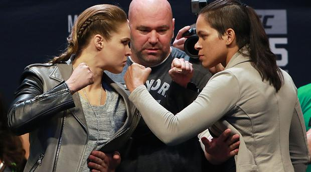 NEW YORK, NY - NOVEMBER 11: UFC Women's Bantamweight Champion Amanda Nunes faces off with Ronda Rousey after UFC 205 Weigh-ins in preparation for their UFC 207 fight that will take place on December 30, 2016 at Madison Square Garden on November 11, 2016 in New York City. (Photo by Michael Reaves/Getty Images)