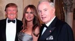 Irish American businessman Brian P Burns, right, with Donald Trump and his wife Melania