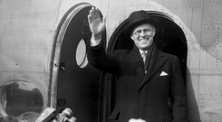 Joseph P. Kennedy greeting the press at the airport as he returns from a trip to the US in 1940 (Photo by J. A. Hampton/Topical Press Agency/Getty Images)