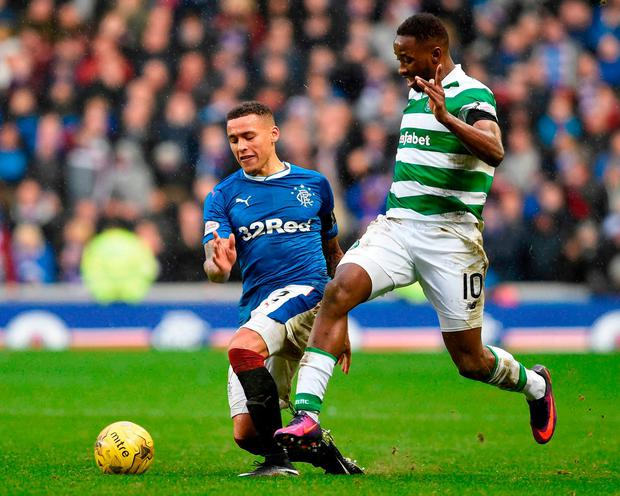Celtic's Moussa Dembele goes past Rangers James Taverier. Photo: Ian Rutherford/PA Wire