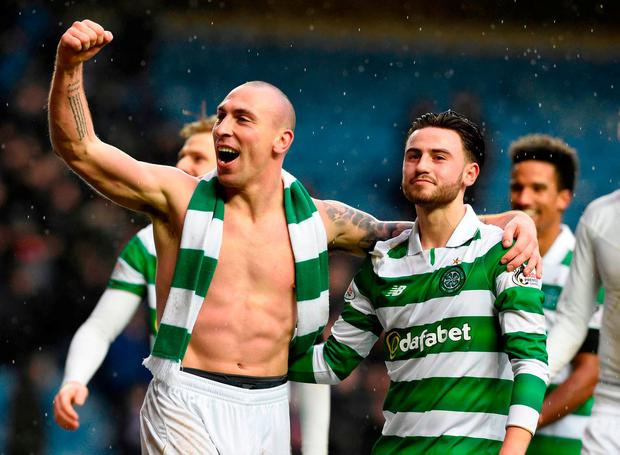 Celtic's Scott Brown and Patrick Roberts celebrate after defeating Rangers 2-1. Photo: Ian Rutherford/PA Wire