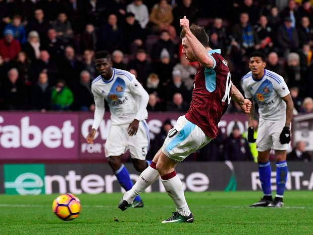 Burnley's Ashley Barnes scores from the penalty spot. Photo: Anthony Devlin/Reuters