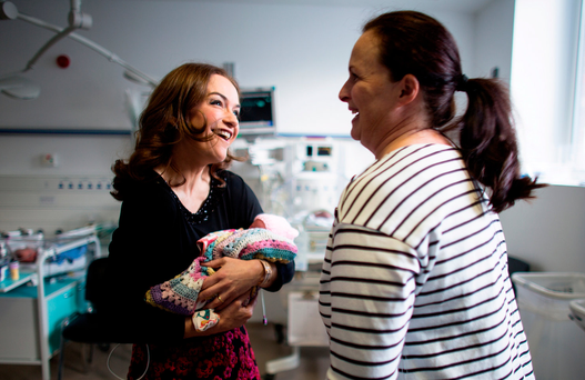 Dr Rhona Mahony, Master of the National Maternity Hospital Holles Street on her morning rounds with Jeanette Dempsey and her baby girl Irenea Croi Picture: David Conachy