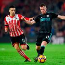 Southampton's Dusan Tadic and West Bromwich Albion's Chris Brunt battle for the ball. Photo: Daniel Hambury/PA Wire