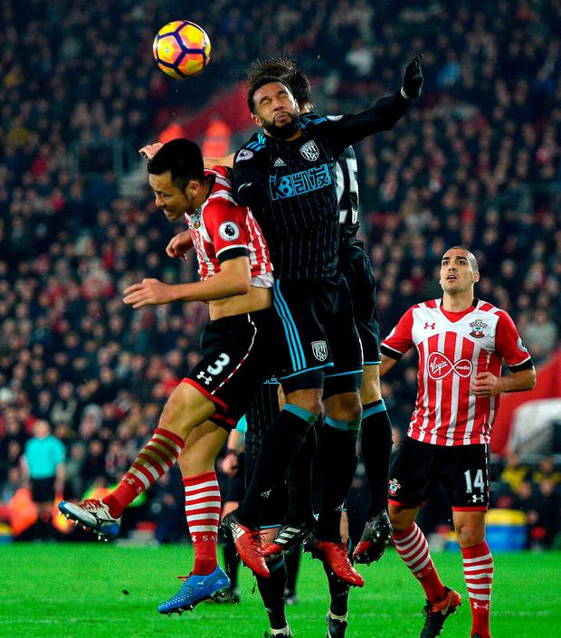 Southampton's Maya Yoshida (left) jumps for possession. Photo: Daniel Hambury/PA Wire