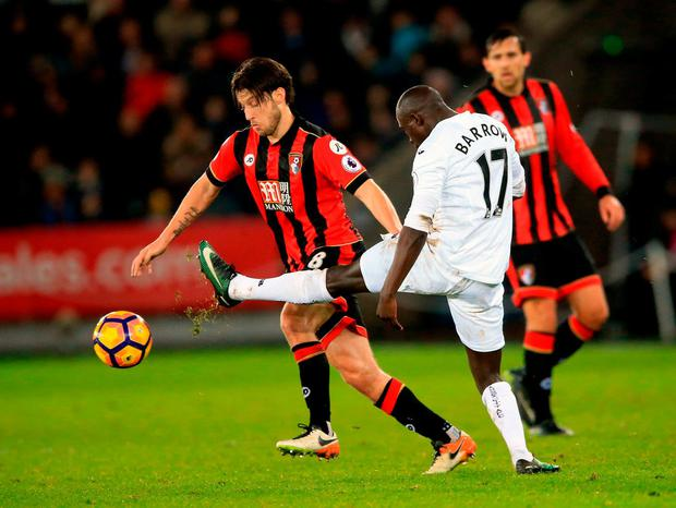 AFC Bournemouth's Harry Arter and Swansea City's Modou Barrow battle for the ball. Photo: Nigel French/PA Wire