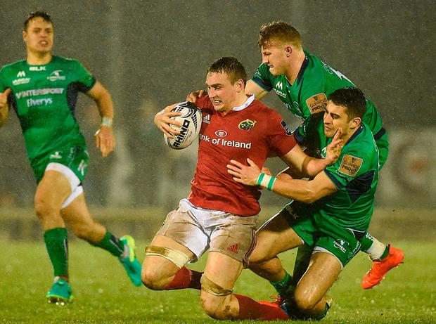 Munster's Tommy O'Donnell is tackled by Connacht's Peter Robb and Tiernan O'Halloran. Photo: Diarmuid Greene/Sportsfile