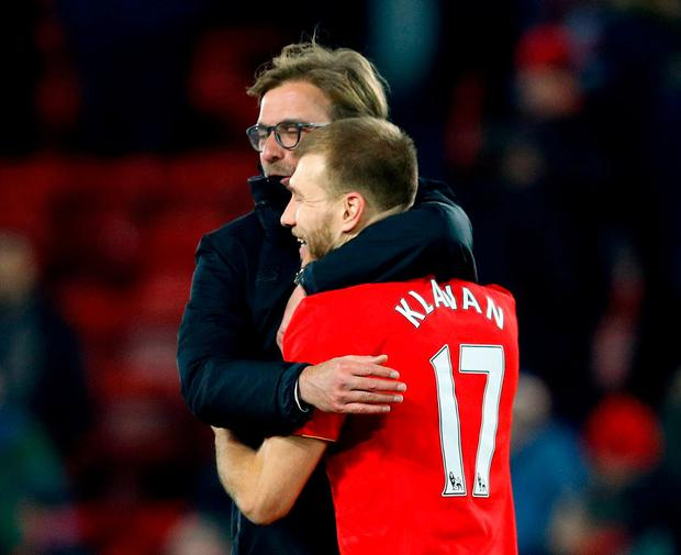 Liverpool manager Juergen Klopp and Liverpool's Ragnar Klavan celebrate after the game. Photo: Phil Noble/Reuters