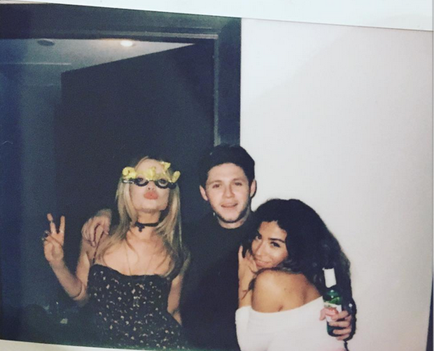 Laura Whitmore, Niall Horan and friend ringing in the new year.