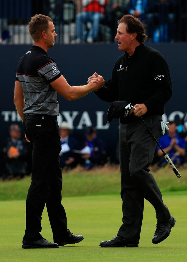 Phil Mickelson and Henrik Stenson congratulate each other at Troon. Photo by Mike Ehrmann/Getty Images