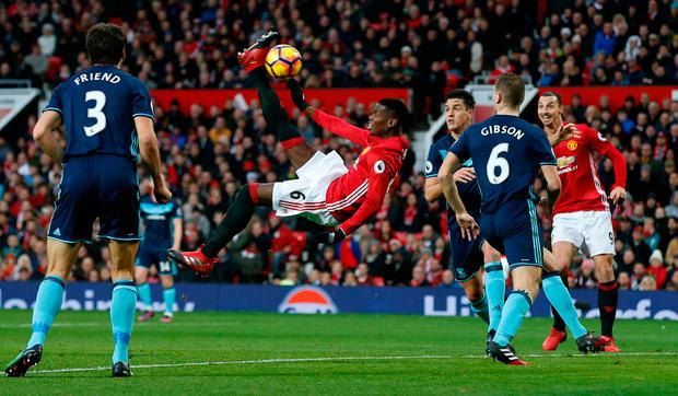 Manchester United's Paul Pogba hits the post with a overhead kick. Photo: Reuters / Andrew Yates