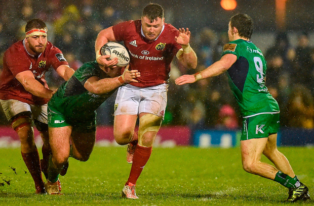Munster's Dave Kilcoyne is tackled by Denis Buckley, left, and Kieran Marmion of Connacht during the Guinness PRO12 Round 12 match. Photo: Diarmuid Greene/Sportsfile