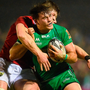 Connacht's Jake Heenan is tackled by Munster's Jack O'Donoghue