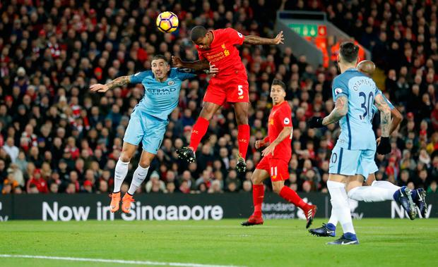 Georginio Wijnaldum soars above the Manchester City defence to score for Liverpool. Photo: Reuters / Carl Recine