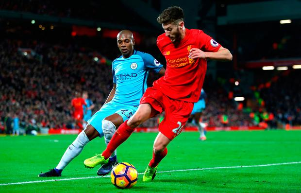 Adam Lallana of Liverpool and Fernandinho of Manchester City in action. Photo by Clive Brunskill/Getty Images