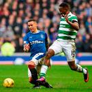 Celtic's Moussa Dembele goes past Rangers James Taverier. Photo credit: Ian Rutherford/PA Wire