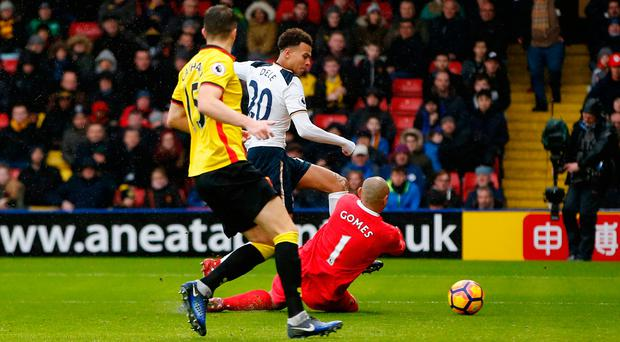 Dele Alli slots his second and Tottenham's fourth goal past Watford goalkeeper Heurelho Gomes. Photo: Reuters / Paul Childs