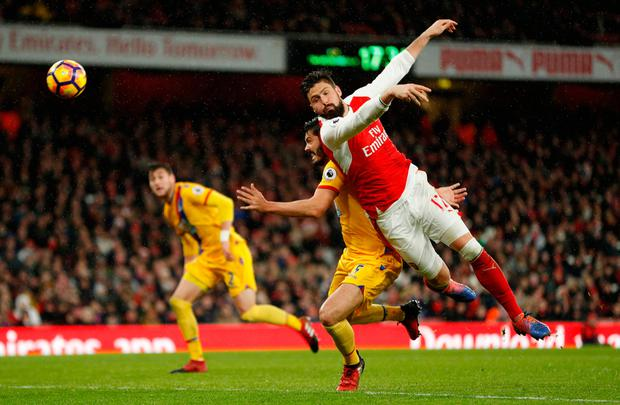 Olivier Giroud – who scored a wonder-goal in the victory against Crystal Palace – in action against James Tompkins. Photo: Reuters / John Sibley