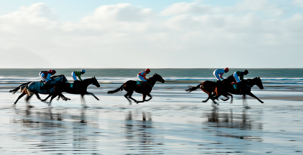Horses and jockeys in action during the Ballyheigue Races on Ballyheigue beach on the edge of the North Atlantic ocean in Co. Kerry Photo: Brendan Moran/Sportsfile