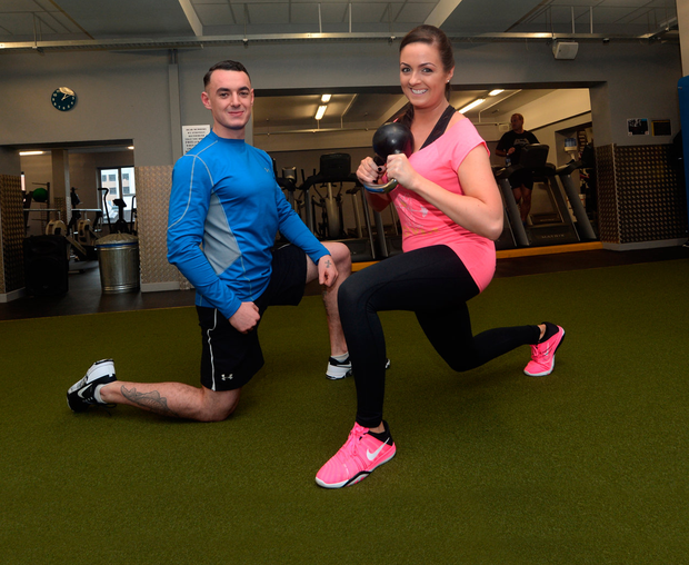 Instructor Mark Holland with his client Lynne Davies at FlyeFit Gym, Baggot Street, Dublin Photo: Caroline Quinn