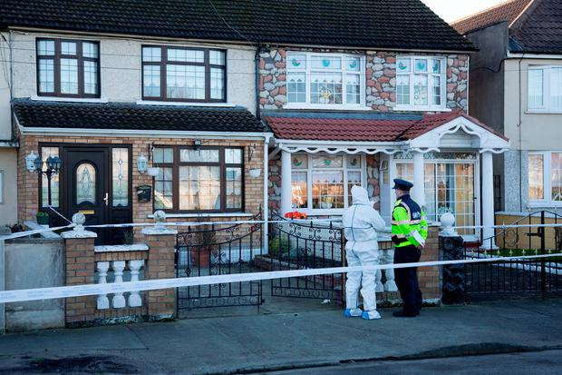 Garda forensic officers collecting evidence at the scene of the stabbing at Oranmore Road, Ballyfermot, yesterday