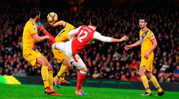 Olivier Giroud of Arsenal scores the opening goal during the Premier League match between Arsenal and Crystal Palace at the Emirates