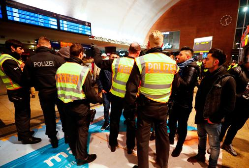 Police officers of Germany's federal police Bundespolizei check young men at the main railways station following New Year celebrations in Cologne, Germany, January 1, 2017. REUTERS/Wolfgang Rattay