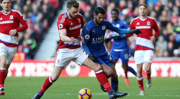 MIDDLESBROUGH, ENGLAND - JANUARY 02: Riyad Mahrez of Leicester City in action with Calum Chambers of Middlesbrough during the Premier League match between Middlesbrough and Leicester City at Riverside Stadium on January 02, 2017 in Middlesbrough, England. (Photo by Plumb Images/Leicester City FC via Getty Images)